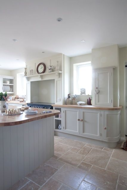 Beautiful country kitchen with a modern feel, created by pale units and a stone floor. Yew Tree Designs  Why not head on over to join our FREE interior design resource library at http://www.TheHomeDesignSchool.com/signup?