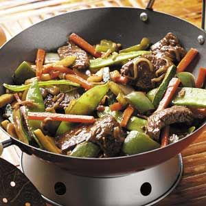 """Colorful Beef Stir-Fry Recipe -""""This recipe might be similar to a beef stir-fry you've had before, but I really like the easy sesame-ginger marinade and the vibrant mix of vegetables,"""" writes Deb Blendermann from Boulder, Colorado."""