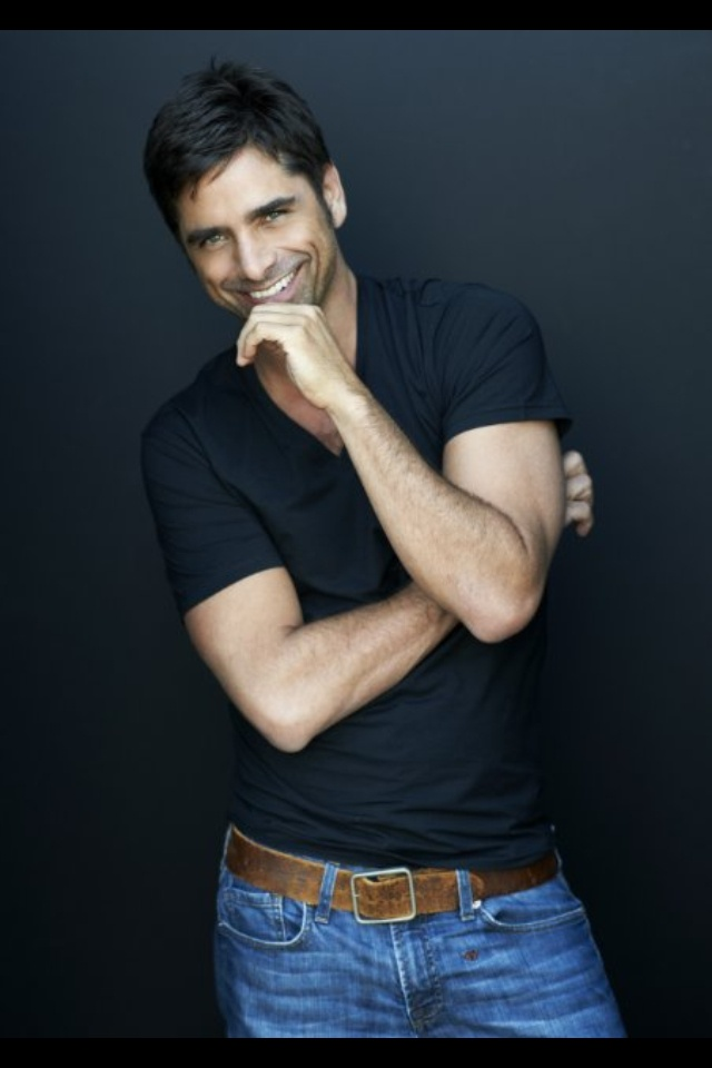 John Stamos.  Yes, he's GORGEOUS, but really he just puts a huge stupid goofy grin on my face & really I just want to hang out with him.