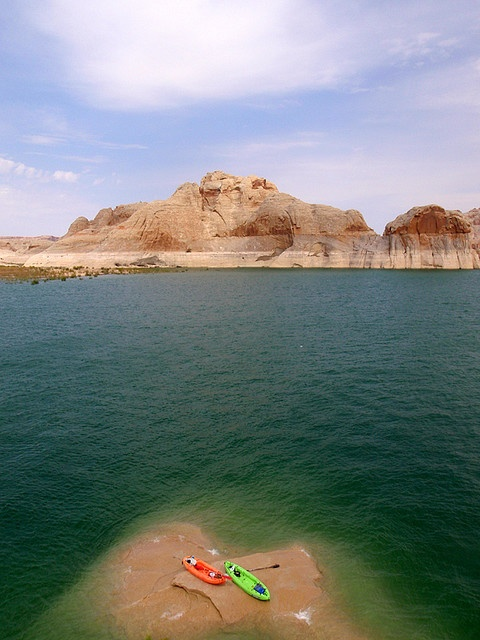 Lake Powel, AZ - This unique area offers some of the most stunning landscapes to be found anywhere. An inland desert sea that formed when Glen Canyon Dam flooded its 'slick rock' canyon, Lake Powell has 1,900 miles of shoreline and 96 narrow side canyons to explore. Camp at the base of towering canyon walls, and paddle over and under the ruins of the Anasazi Indians.