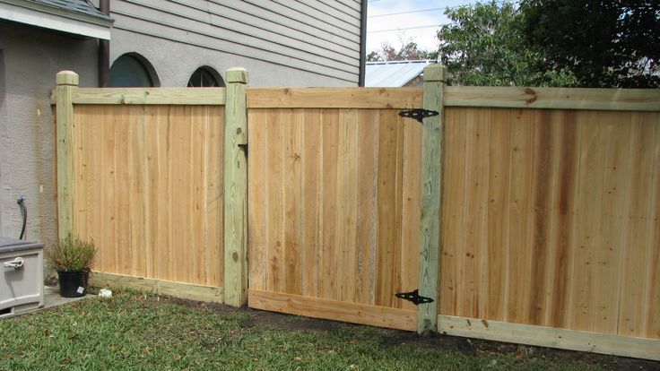 Custom Capped Board-on-board Wood Privacy Fence By Mossy