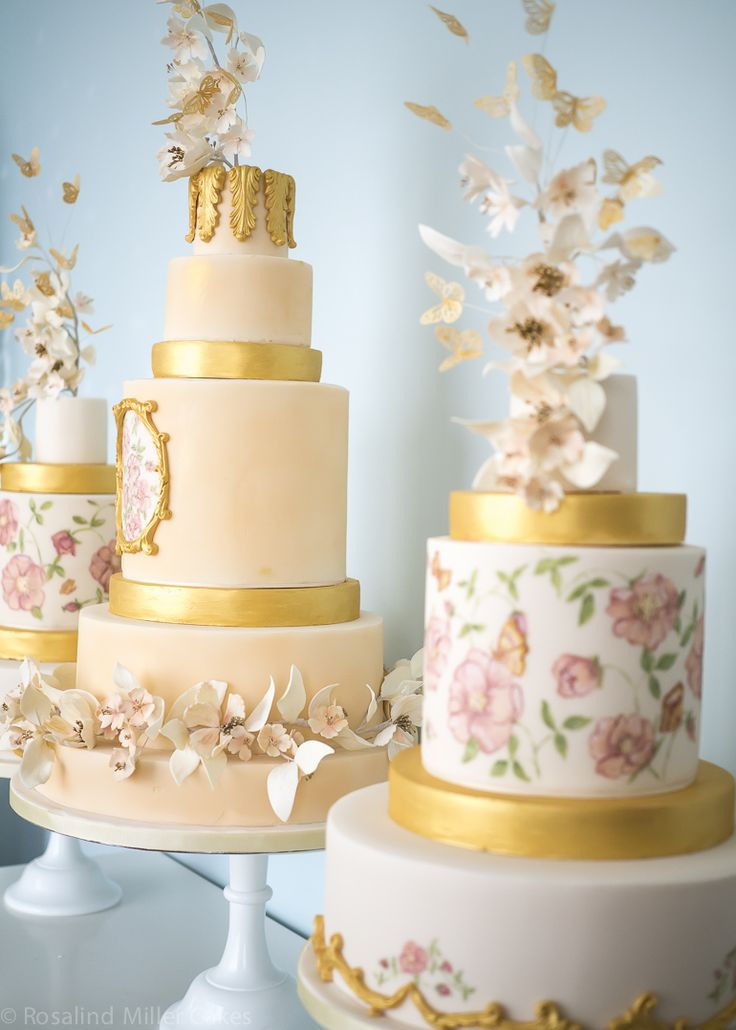 These gold detail wedding cakes are amazing.