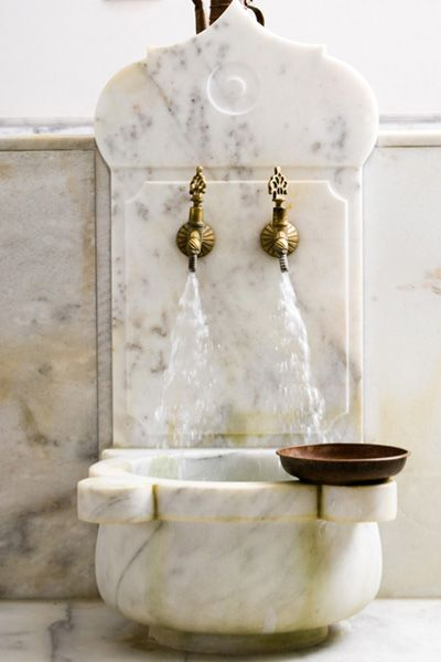 The lapping of the water taps is all part of background noise in the hammam