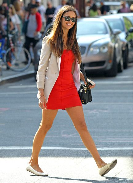 A great way to wear a mini dress during the day. Nina Dobrev adds a boyfriend blazer and classic ballet flats.