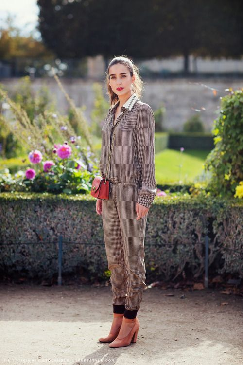 Victoria looking amazing in the one piece combined with a red leather cross bag and Stella MacCartney apricot shoes.