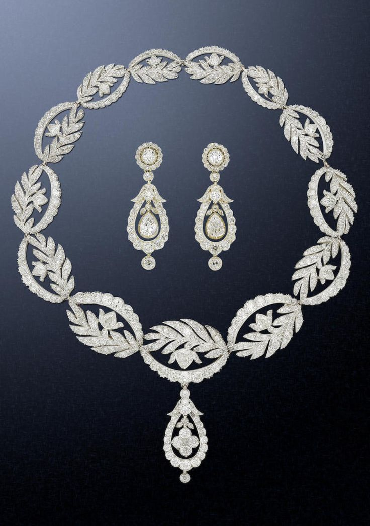 A Georgian diamond necklace and earring suite, circa 1820.  The necklace composed of a series of graduating openwork elliptical links, each with highly stylised floral and foliate decoration, suspending a detachable pear-shaped drop with quatrefoil centre, accompanied by a pair of pendent earrings of similar drop-shaped design, with central pear-shaped, mounted in silver and gold, can be formed into a bracelet, the two largest links can be worn as brooches. #antique #Georgian #necklace…