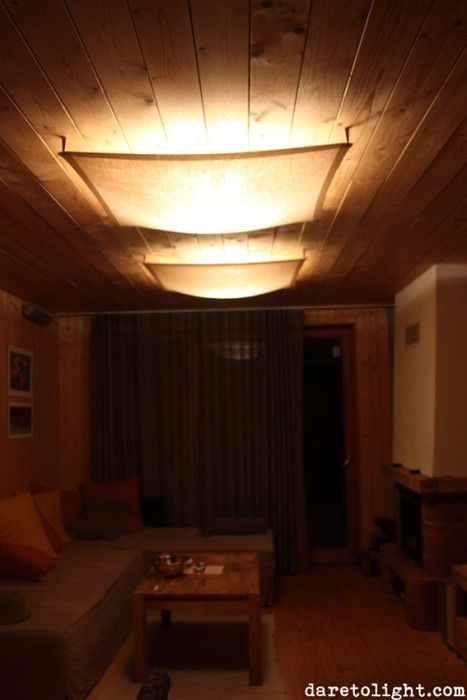 A fluorescent light is hidden behind a transparent canvas veil in a ceiling of a cottage