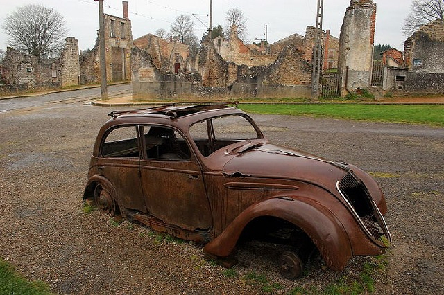 This town was left as a memorial after ww2. The SS had killed the inhabitants as reparations for Resistance activity. The houses/cars etc were never touched again even by thieve