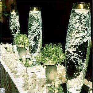 vases with lights on the bottom | Glass vases with baby's breath and floating candle ... | Wedding Deta ...