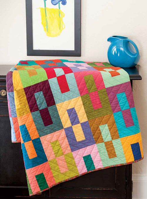 """Color Study–Modern Scrap Quilt, 54 x 84"""", by Kristine Peterson.  Machine quilted by Kelly Van Vliet. Inspired by a design by Janine Burke of Blue Underground Studio"""