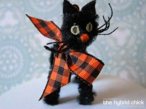 Make a black cat out of a pipe cleaner.
