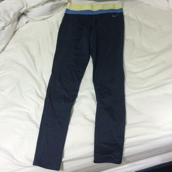 Nike running pants Nike running pants, navy blue, wide waist band, fleece lined. Good condition Nike Pants