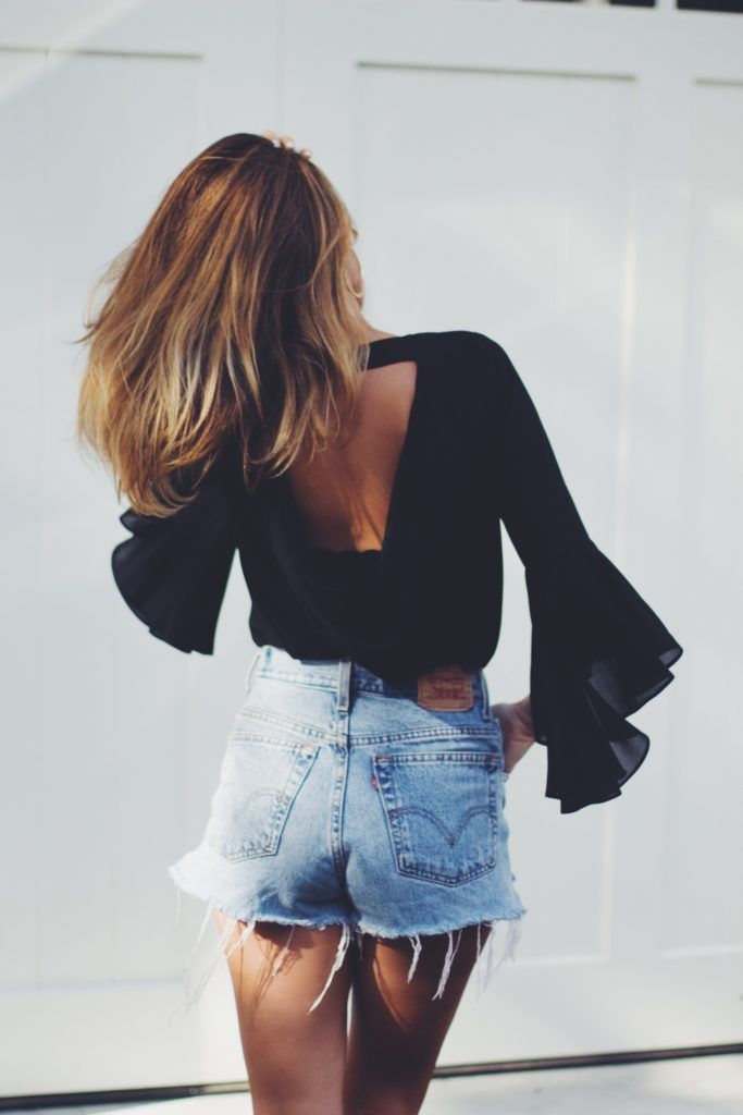 black bell sleeve blouse and levi's cutoffs