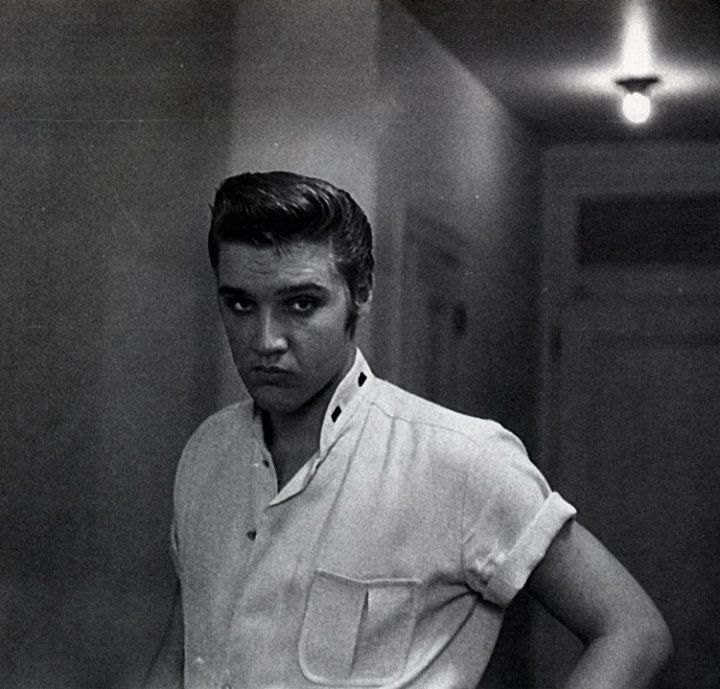 "Elvis photographed by journalist Lloyd Shearer on the sixth floor of the Peabody Hotel in Memphis, TN in the last week of July 1956, on assignment for ""Parade"" magazine. Later that day Elvis would get a fresh haircut at Jim's Barber Shop on Main Street in Memphis."
