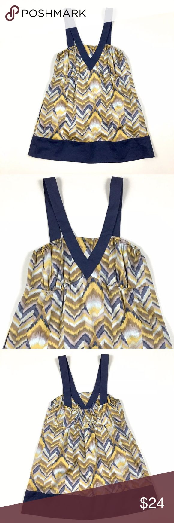BCBGeneration Blue & Yellow Tank Size:  XS Color:  Yellow, Blue, Tan and White Material:  100% Cotton Details:  Smocked Back, Side Seam Pockets Care:  Machine Wash Condition:  No Rips or Stains All measurements are in inches and taken with garment laying flat.  Not doubled.  Bust:  12 Waist:  14 1/2 Hem:  20 Shoulder to Hem:  25 1/2  Item:  5260417388 BCBGeneration Tops