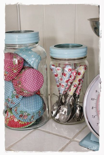 Use glass jars to store pretty little extras.. Kath Kidston spoons + GreenGate cupcake liners.