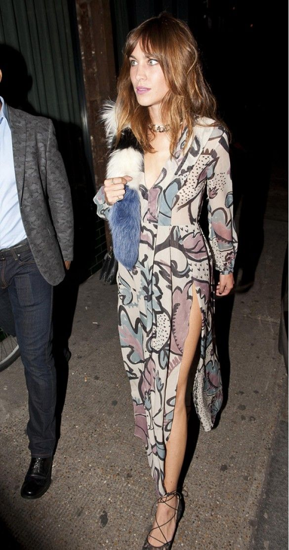 Alexa Chung is a boho babe in a printed high-slit maxi dress, faux fur scarf by Charlotte Simone and lace-up flats