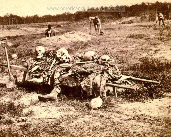 "*AMERICAN CIVIL WAR DEAD ~ Collecting remains of the dead. LOC Summary: ""This is a ghastly view showing the process of collecting the remains of Union soldiers who were hastily buried at the time of the battle.""."