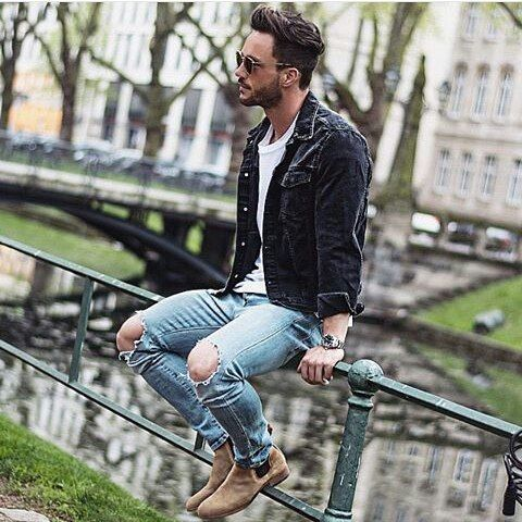 Wear a black denim jacket with light blue distressed skinny jeans to get a laid-back yet stylish look. Feeling inventive? Complement your outfit with tan suede chelsea boots.   Shop this look on Lookastic: https://lookastic.com/men/looks/black-denim-jacket-white-crew-neck-t-shirt-light-blue-skinny-jeans/18364   — White Crew-neck T-shirt  — Black Denim Jacket  — Light Blue Ripped Skinny Jeans  — Tan Suede Chelsea Boots
