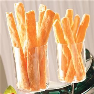Easy Cheese Straws Recipe -Five ingredients transform into long, crisp cracker sticks. The hand-held snacks make for easy mingling at parties.—Elizabeth Robinson, Conroe, Texas