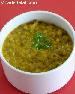 The use of whole green gram or moong is very common in day-to-day gujarati fare. Khatta moong is a lovely recipe that features cooked moong simmered with curds and spices. The use of curds bestows a unique, sumptuous feel to this recipe. Garlic-lovers can even add a little garlic paste to add a whole new dimension to this item.
