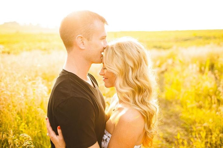 Engagement photography but with sunflowers behind us
