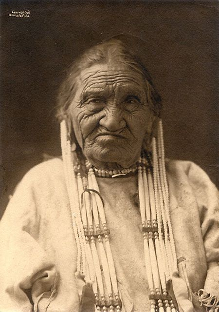 Yellow Eyes (Ishtazi or Istha Zha Zha), Lakota Nation, photo by Frank Fiske 1906.  Yellow Eyes was an informant for Sitting Bull and was with him at the Battle of Little Big Horn.  She and her family escaped with him to Canada and returned with him when he surrendered in 1881.  She went on to Fort Peck with her son and husband and the other warriors. Information obtained from one of her descendants, Dorothy Eiken.