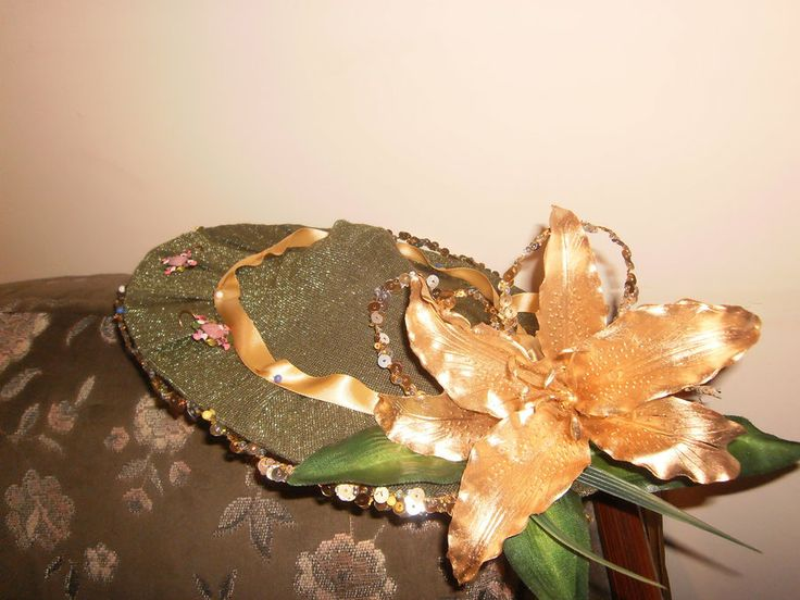 Green and gold lily hat for college ball
