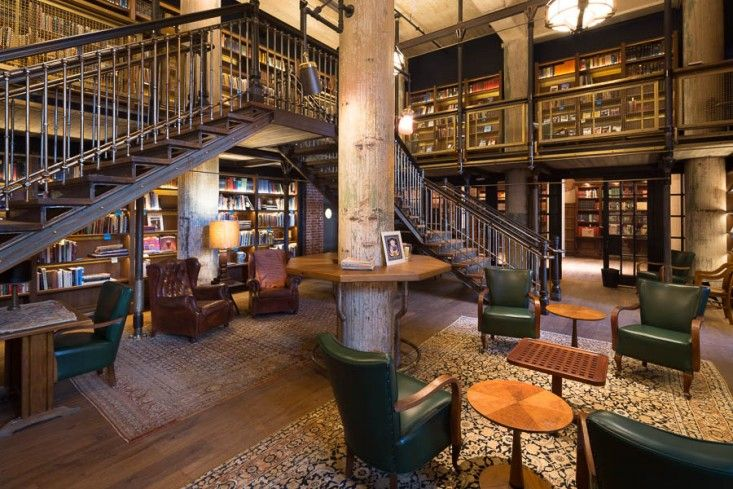 two-tiered 3,700 volume in-house library in the new Hotel Emma in San Antonio, built in the 1898 Pearl Brewery, designed by Roman and Williams, 2015