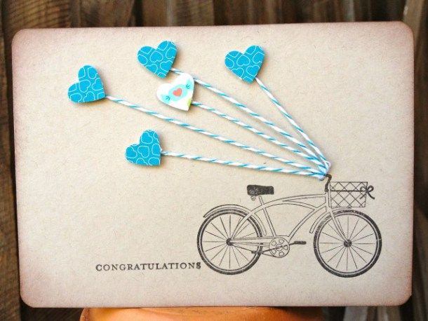 A bicycle on the go will pull your heart on a string when you make this handmade congratulations card. Use 5 hearts for a 5th birthday, or any number or color to make this card for someone special.
