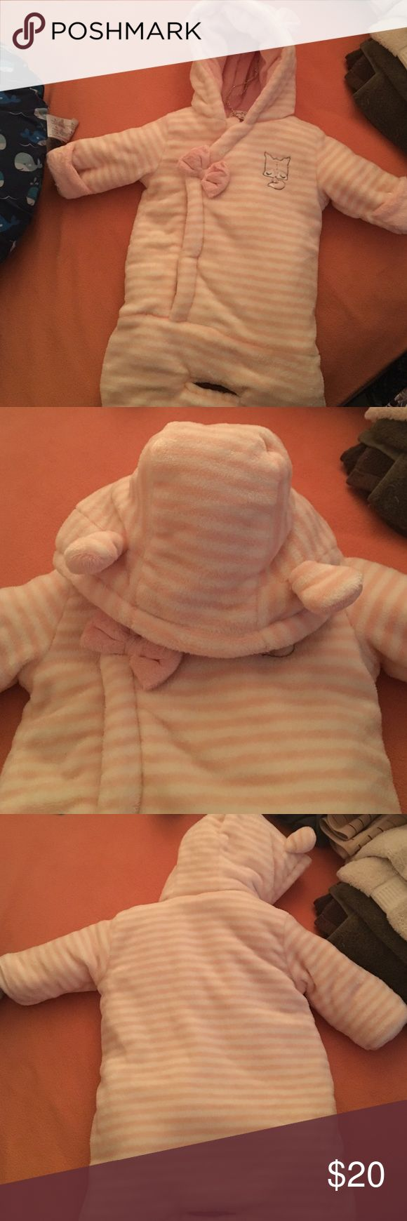 Jessica's Simpson's infant's coat This coat is perfect for winter and great for the car seat. Very soft, has a hood and able to cover hands. Snaps in the front. This is best for smaller babies like 2-6 months old. Jessica Simpson Jackets & Coats