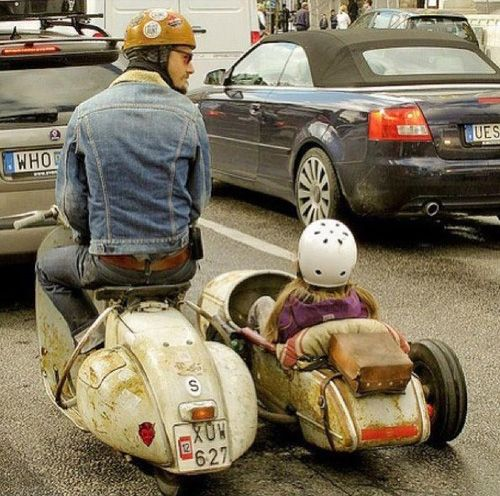 Lowered vintage scooter with sidecar