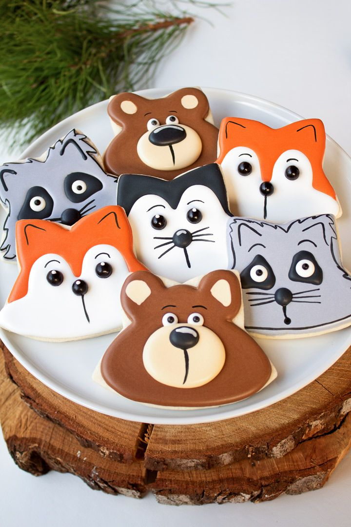 Woodland Cookies- Sugar cookie recipe, royal icing a star cookie cutter is all you need to make bear, fox, raccoon, and skunk cookies. Tutorial and Video