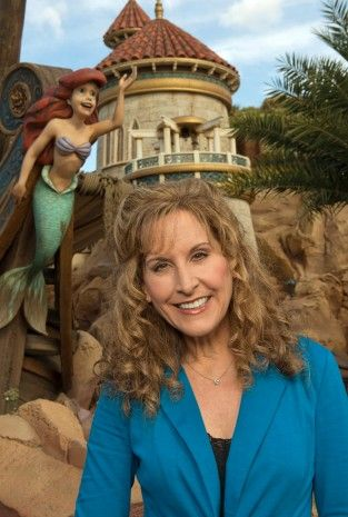 Actress and singer Jodi Benson, who provided the voice of Ariel in Disney's animated classic 'The Little Mermaid,' poses December 6, 2012 at the 'Under the Sea ~ Journey of the Little Mermaid' attraction at the Magic Kingdom - Grand Opening of New Fantasyland at Walt Disney World Resort.
