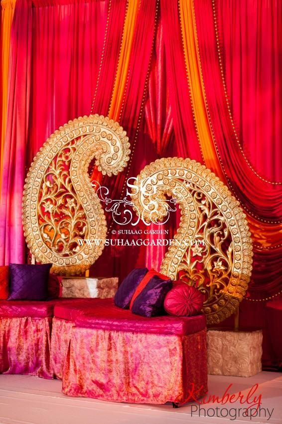 Suhaag Garden, Florida Indian wedding decorator, Mehndi stage, paisley backdrop, colorful drapery
