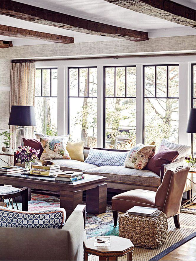 Thom Filicia lake house. Like the pillows and lamps. Warm. I would pull out one of the side tables