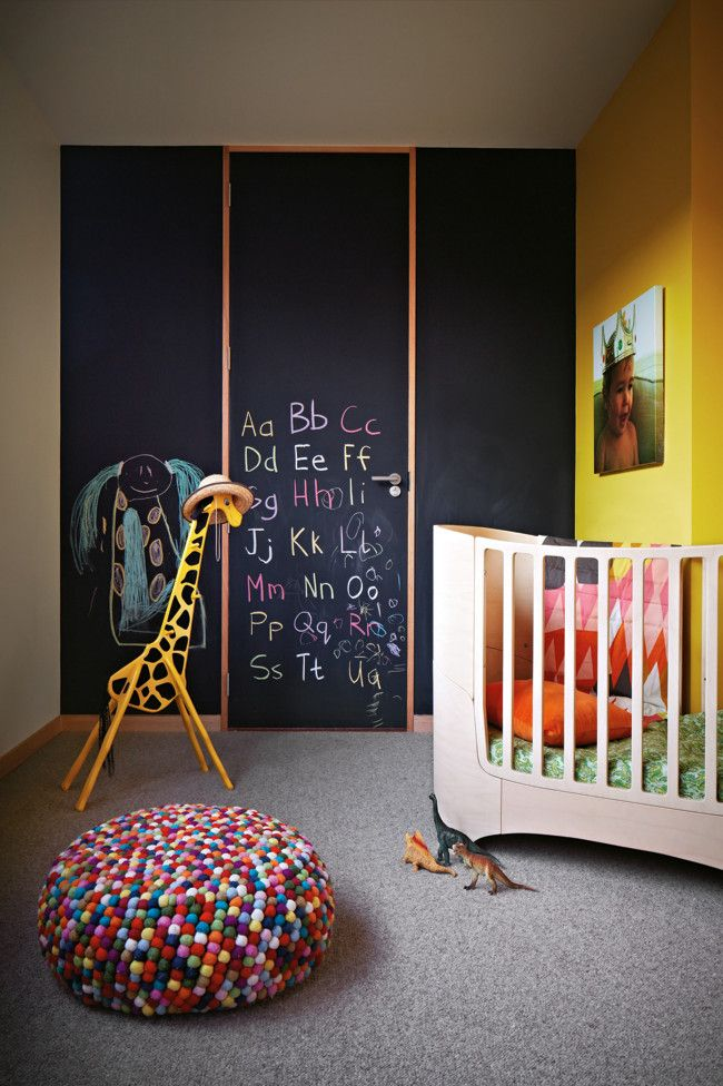 chalkboard walls  door with yellow accent walls trim and giraffe go bold for nurseries instead of the usual pastels