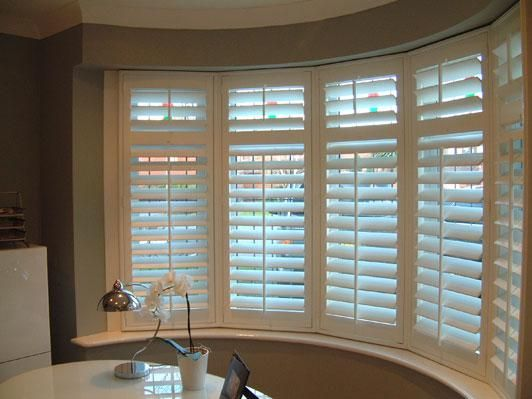 Blinds for a 1930s bay window - Shutters work in bay windows too!! Wide slats allow for increased views. Budget Blinds of Benton