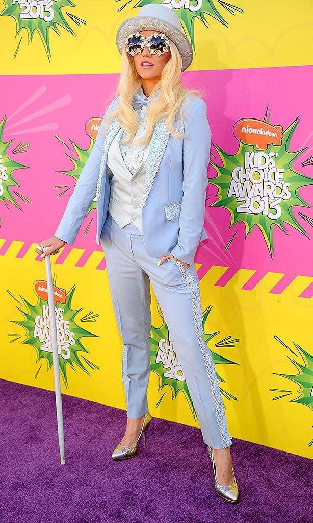 Ke$ha in front of TRIO's printed step repeat at the Kid's Choice Awards 2013