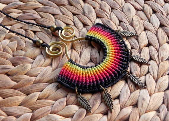 Beautiful necklace made with macrame technique. I used brazilian waxed thread in black and yellow, orange, red and purple hues, brass beads and brass