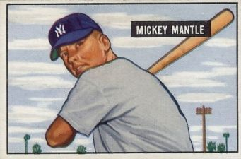 Today is Mickey Mantle's birthday.  Issued a year before his Topps debut, Mantle's true rookie card comes from 1951 Bowman Baseball. The painted image features a young Mantle standing against a cloudy backdrop.