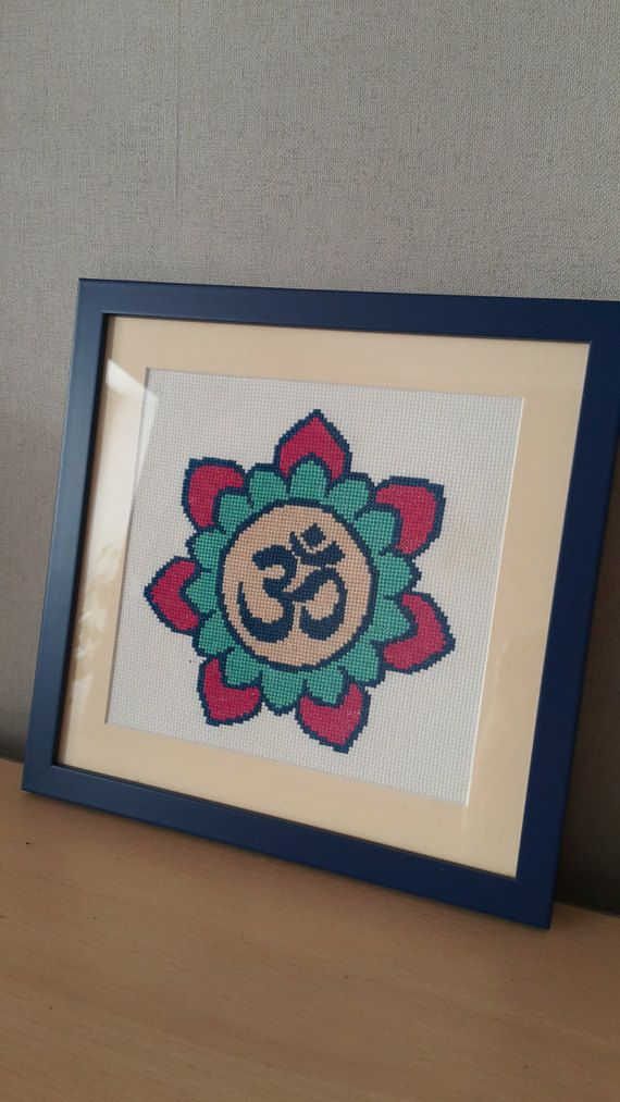 Check out this item in my Etsy shop https://www.etsy.com/ru/listing/511123495/cross-stitched-picture-om-sign