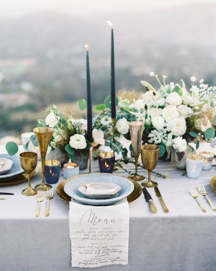 blue and gold tablescape with cloth menu detail