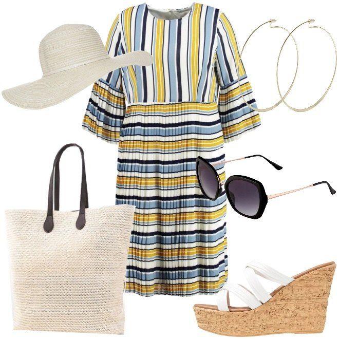 Una proposta colorata, perfetta per una giornata in barca o per un aperitivo in tarda serata, dopo una giornata in spiaggia. Il vestito al ginocchio in fantasia rigata multicolore ha lo scollo arrotondato e le maniche a campana, con lunghezza a 3/4 , con leggero effetto plissettato. Gli accessori richiamano calde atmosfere estive, con il cappello a falda larga in beige/avorio, la borsa a mano con doppio manico in nuance ed i sandali bianchi, con ...