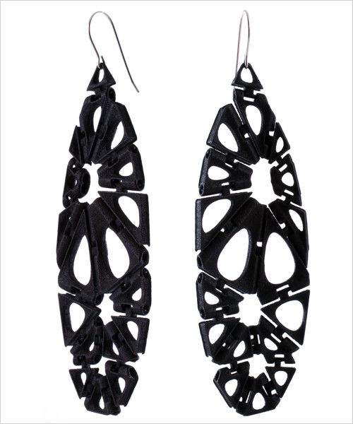 Stylish with a modern twist, these 3D printed earrings are simple, flexible and incredibly lightweight with a teardrop silhouette. Available in black, red and white. - 3D printed