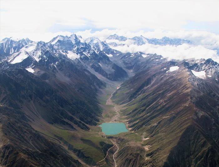"""The Karakoram Highway, China/Pakistan is the highest paved international road in the world. It connects China and Pakistan across the Karakoram mountain range, through the Khunjerab Pass, at an elev. of 15,397 ft. It connects China's Xinjiang region w/Pakistan's Gilgit–Baltistan & Khyber Pakhtunkhwa regions& also serves as a popular tourist attraction. Due to its high elevation and the difficult conditions in which it was constructed, it is also referred to as the """"Eighth Wonder of the…"""