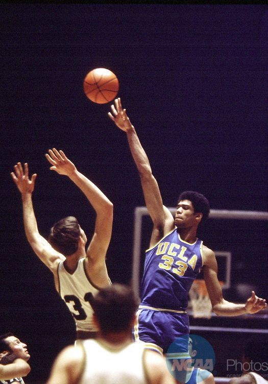 """22 MAR 1969:  Lew Alcindor """"Kareem Abdul-Jabbar"""" (33) puts up a shot over a Purdue defender during the Men's Final Four Basketball Championship game held in Louisville, KY at Freedom Hall. Ucla defeated Purdue 92-72 for the title"""