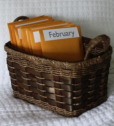 I think I'm going to try to pull this one off. There are 12 envelopes and inside each one is a pre-planned or pre-paid date! Too cute :)