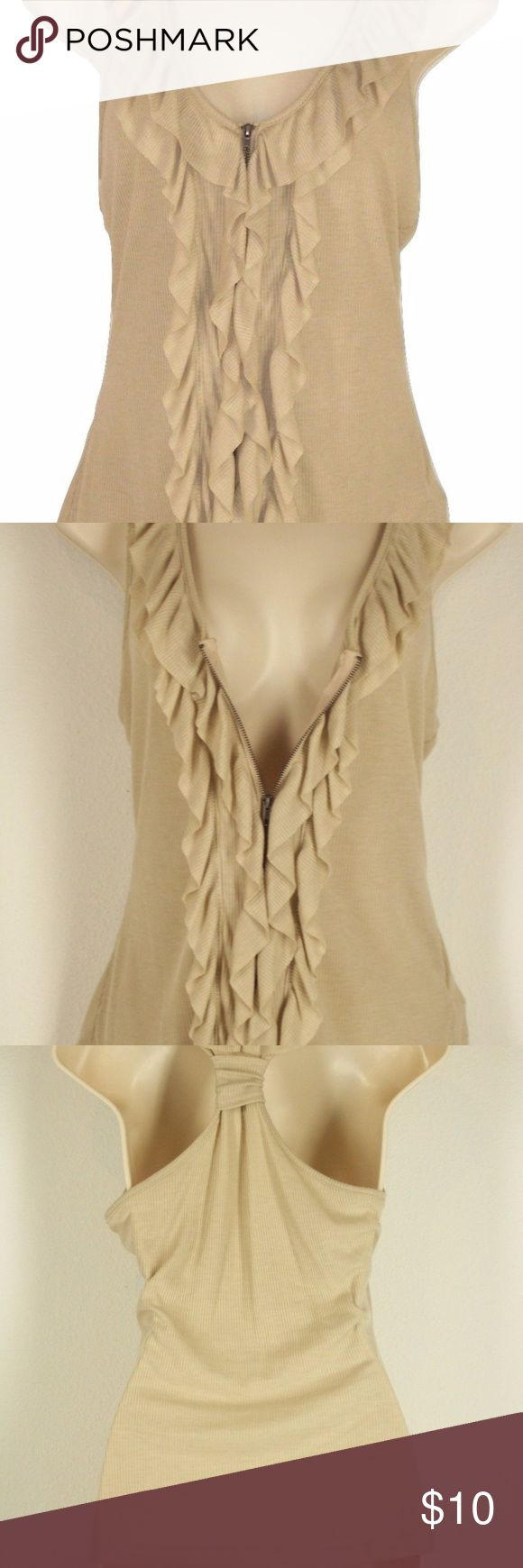 "Beige Ruffled Zip Up Racerback Sleeveless Top This is a sleeveless beige women's top in excellent, like-new condition. Only worn once.  Very feminine, soft and neutral. Can be paired with jeans, slacks or a skirt. Racerback with ruffled zipper front.  Chest 15"" Length 25"" mine Tops"