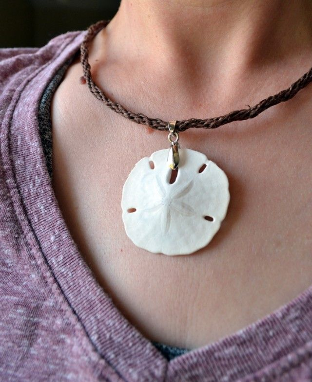 A DIY sand dollar necklace that turns a little beach vacation find into a keepsake.